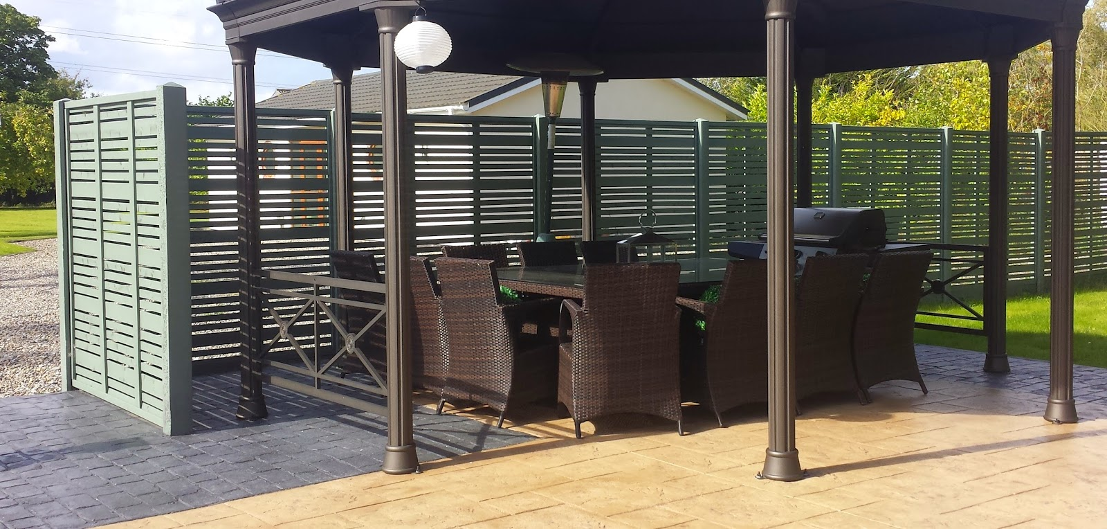 Modern garden fencing screens to the right hand side the milan panels have been used to create this superb al fresco entertaining area baanklon Images