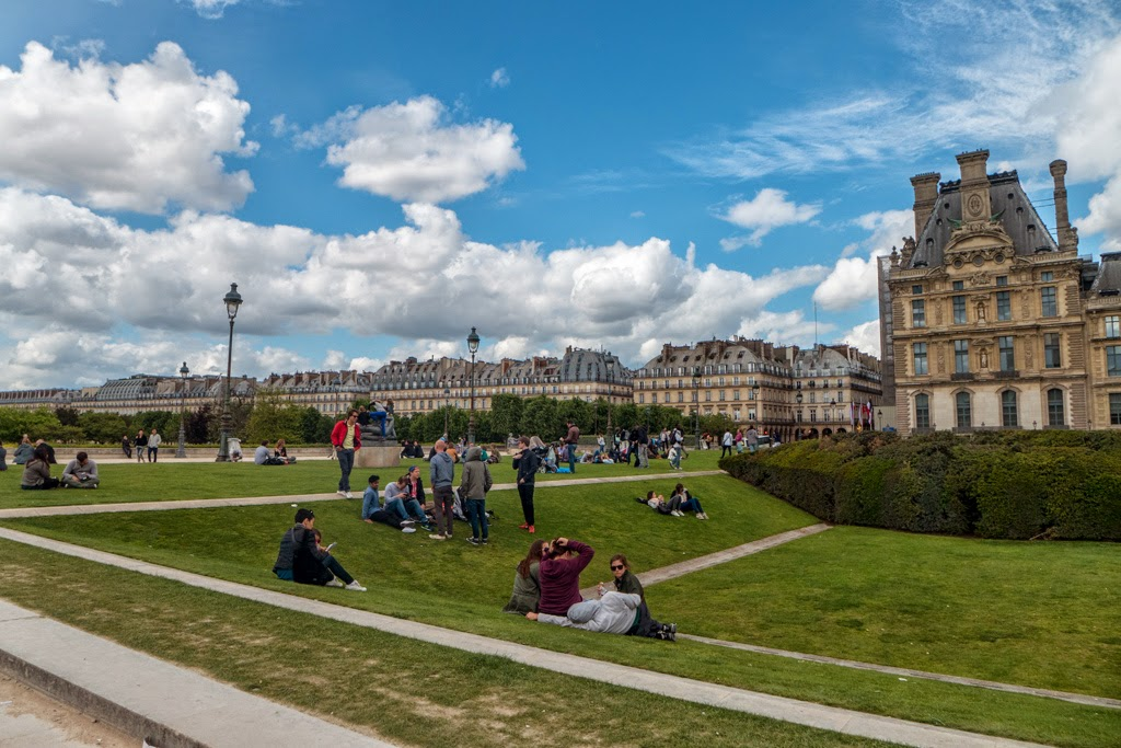Paris France gardens at the Louvre blue sky with white clouds