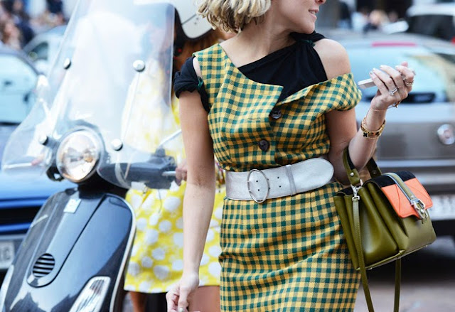 Woman wearing a yellow and teal gingham dress from Prada's Fall 2013 collection