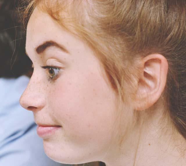 Girl pulling face