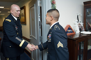 GEN Raymond Odierno, Chief of Staff of the Army, welcomed SGT Saral Shrestha to his office at the Pentagon and presented him with an award for his recent win at the Best Warrior Competition.