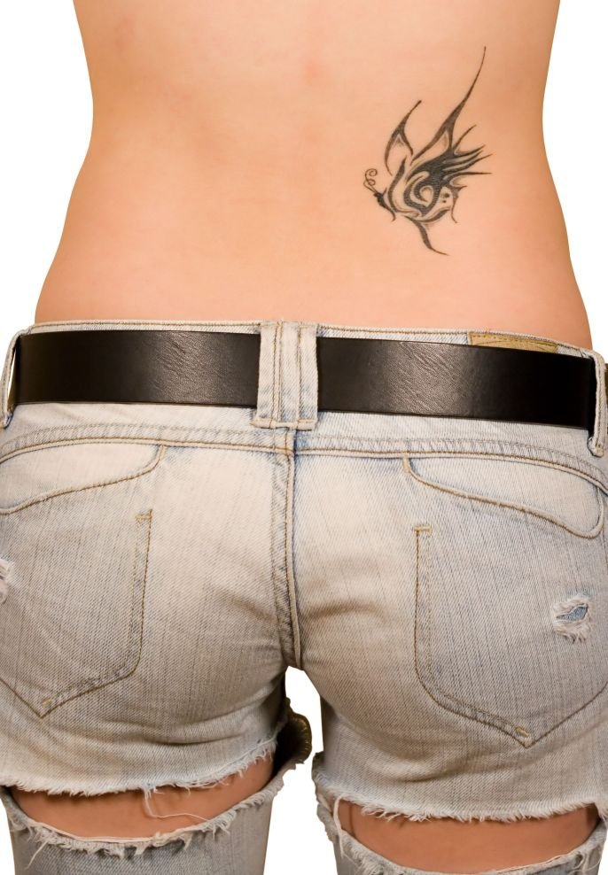 small butterfly tattoos. tattoo designs for girls lower