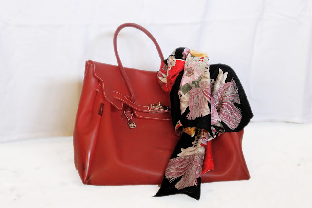 red bag and floral scarf
