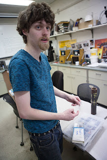 Daniel Carrick shows equipment used in radiographic materials testing, during an NDT class at UAA. (Photo by Philip Hall/University of Alaska Anchorage)