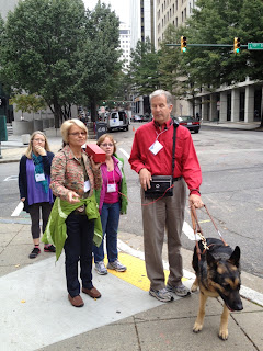 Mike and O&M Instructors listening to Accessible GPS at an intersection corner