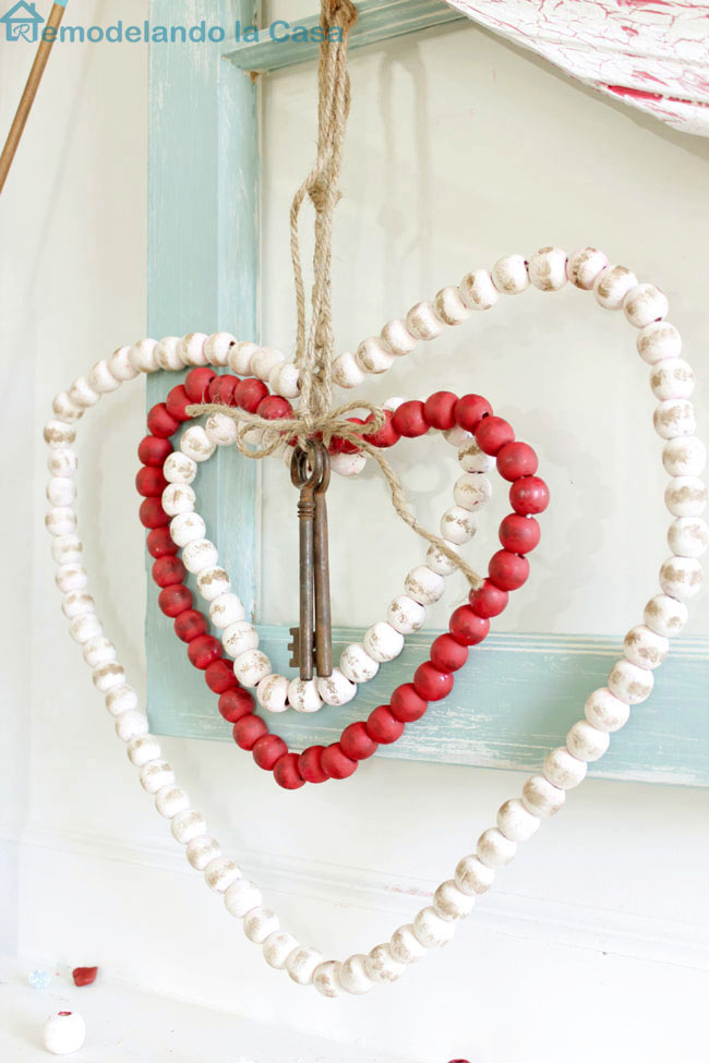 a beaded Christmas garland is upcycled into rustic hearts for Valentines.