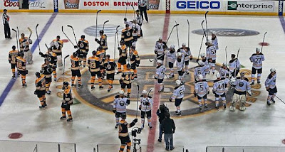 Bruins and Sabres gather center ice post game to salute the crowd