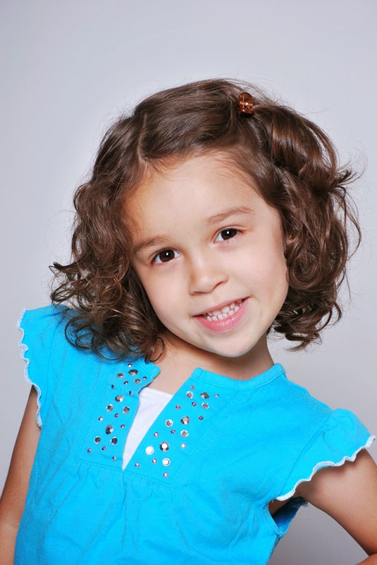 headshot of a child actor in washington dc with a cute smile