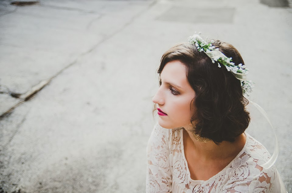 a girl poses for a dream senior portrait with a flower crown and white lace in indianapolis