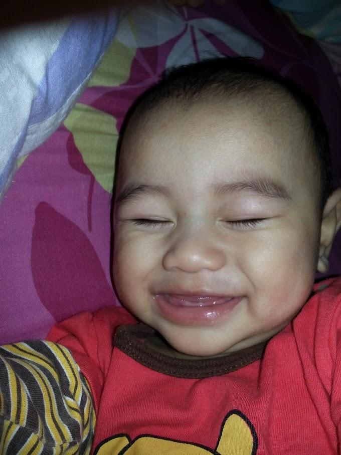 Faris dah tumbuh gigi!!