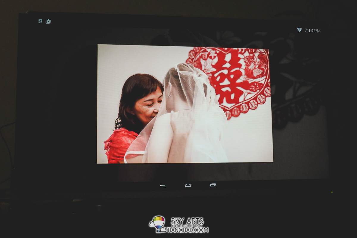 Wedding photo slideshow playing on Toshiba Pro Theatre L5400 Series