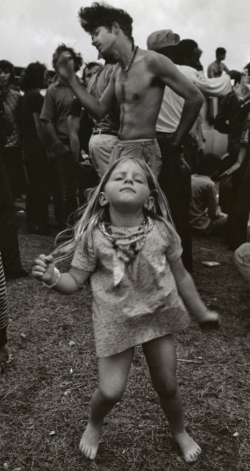 A young hippie girl dancing at a festival in new orleans louisiana 1972