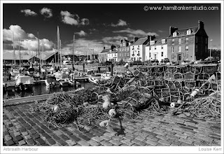 angus scotland lobster pot boat harbour mast black white texture seaside houses fishing net