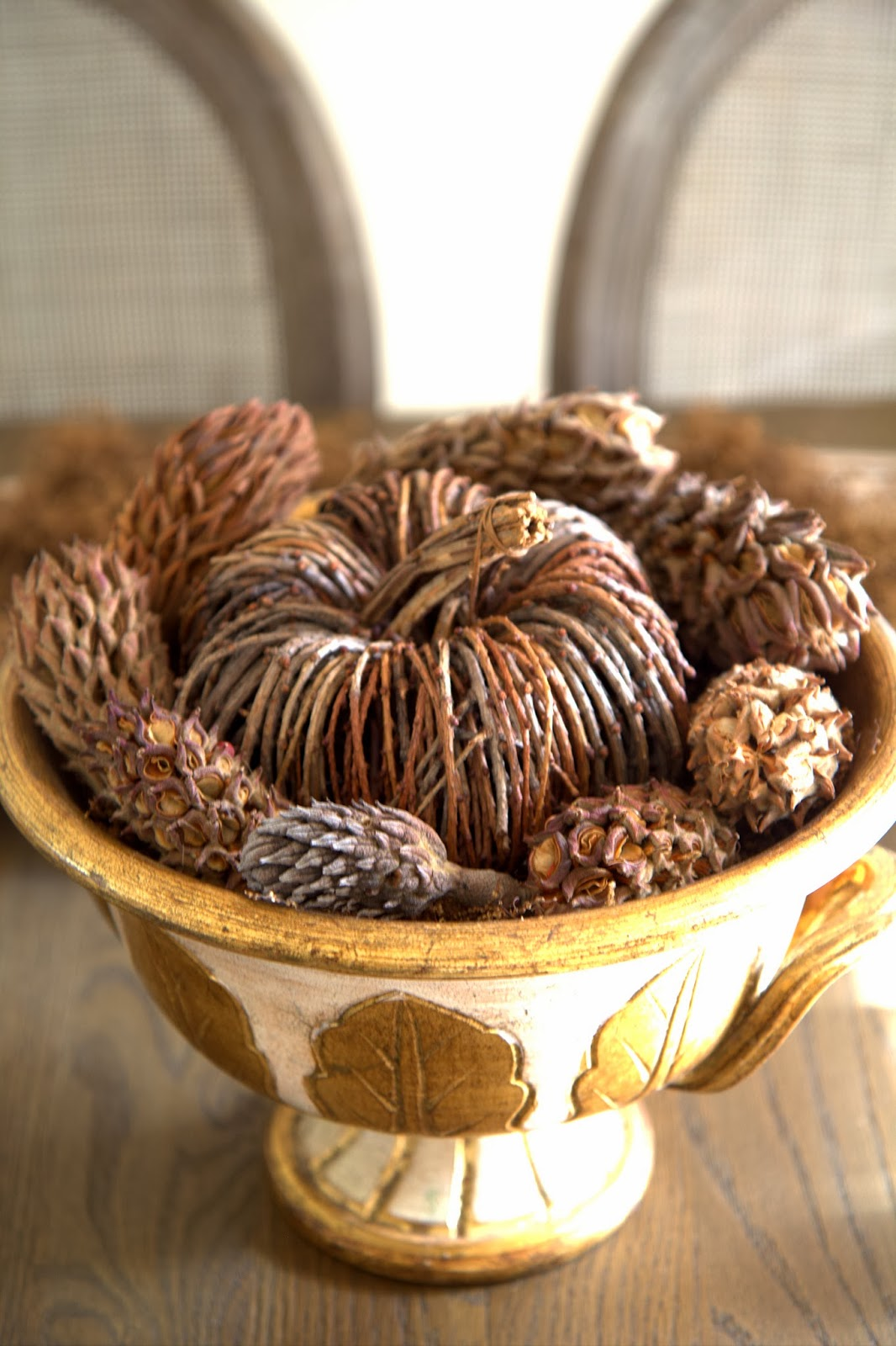 Pumpkin in Gold Antique Bowl with Pinecones
