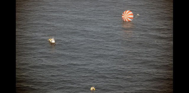 Recovery boats approach Dragon after splashdown into the Pacific Ocean. Photo: SpaceX