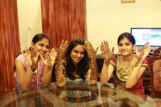 South Indian girls wearing Mehendi in their both hands.