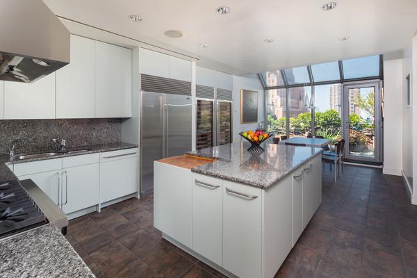 Photo of modern kitchen interiors in 66 Leonard Street Penthouse