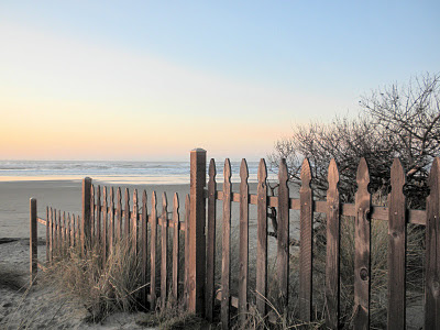 photo of a Rockaway, Oregon beach fence by Nancy Zavada