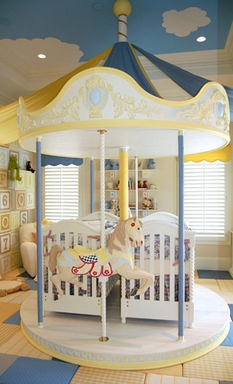 [A fairytale children's room with carousel which carries two cribs for the twins]