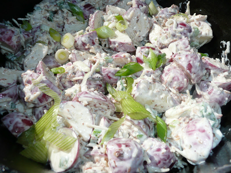 Toss potatoes with cheese, dressing, scallions and bacon bits and ...