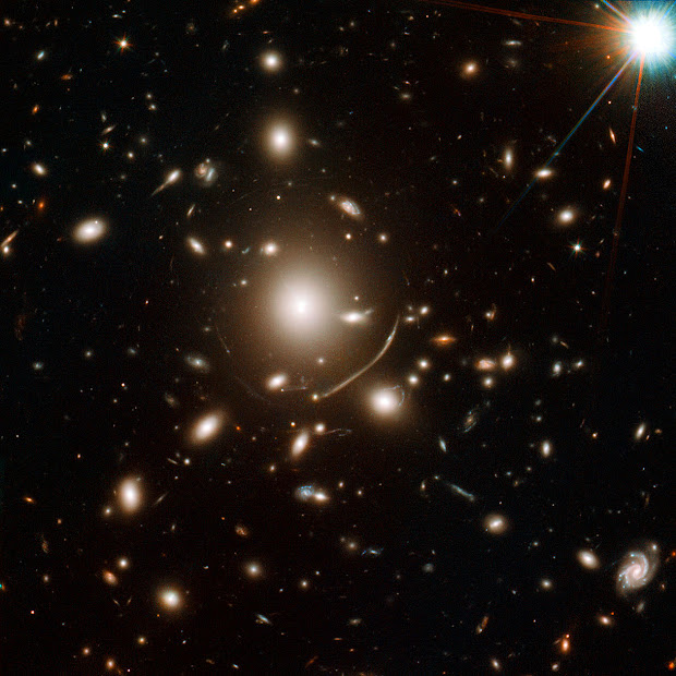 Strong Gravitational Lensing in giant Galaxy Cluster Abell 383