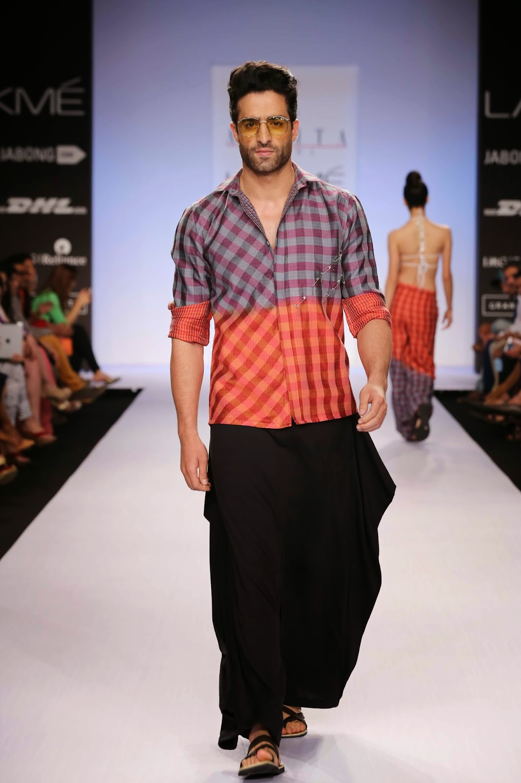 Presenting four men's wear entries Asmita ensured that they followed the resort wear theme. Jersey samurai pants were worn with Chanderi dip dyed shirts and voile short sleeved kurtas were teamed with black denims.