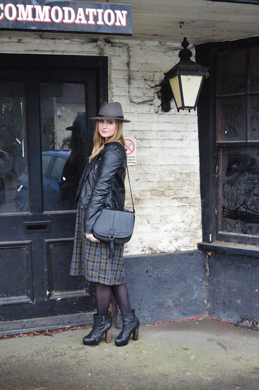 Leather jacket and tartan dress outfit inspiration by fashion blogger FashionFake
