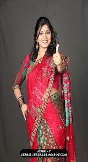 Anchor Jhansi in red saree