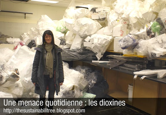 An employee stands in front of a mountain of plastic in a laboratory