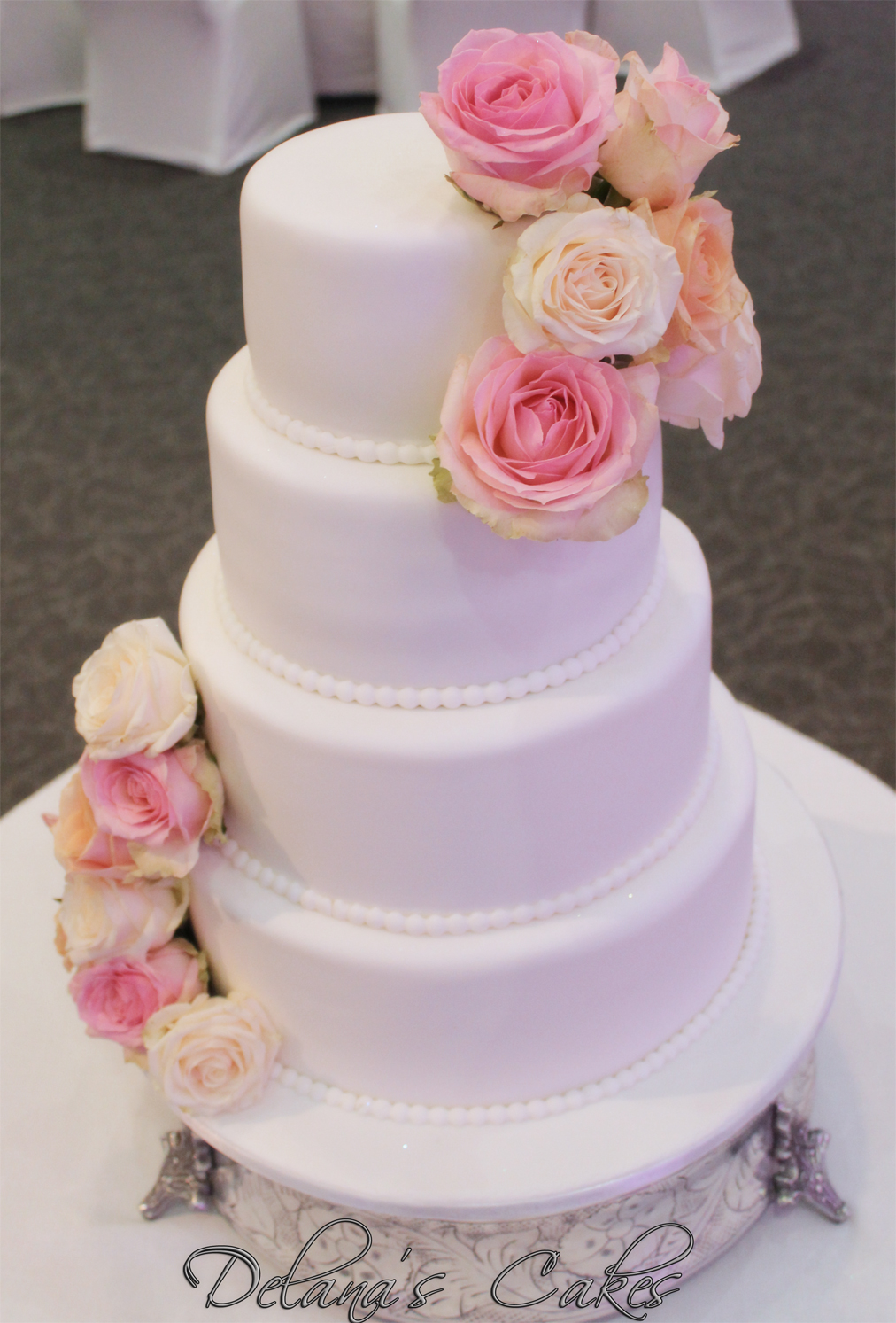 Plain White Wedding Cake With Fresh Roses