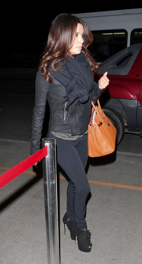 Eva Longoria at LAX Airport Los Angeles in high heels and tight black pants