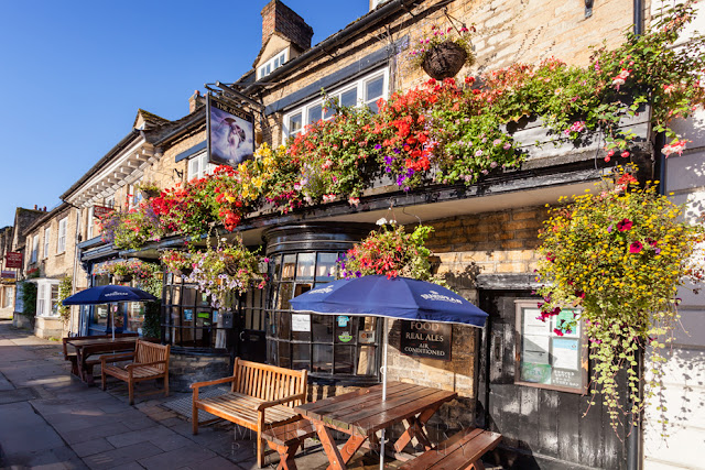 The Angel pub on the church green in Witney Oxfordshire by Martyn Ferry Photography
