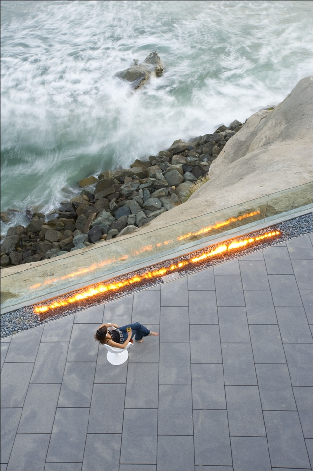 Picture of large terrace with the outdoor fireplace above the ocean