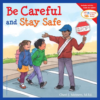 children going to school and trafficman with Stop, Be careful and stay safe