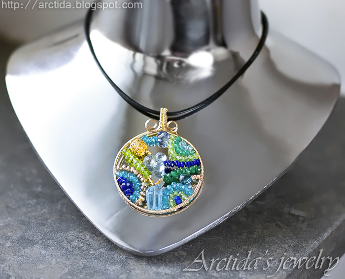 http://www.arctida.com/en/home/109-mosaic-necklace-ooak-apatite-emerald-iolite-lapis-lazuli-peridot-pyrite-and-blue-topaz-necklace-in-14k-gold-filled.html