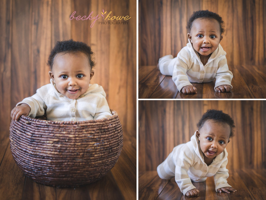 six month old photography session boy sitting basket tripoding smiling
