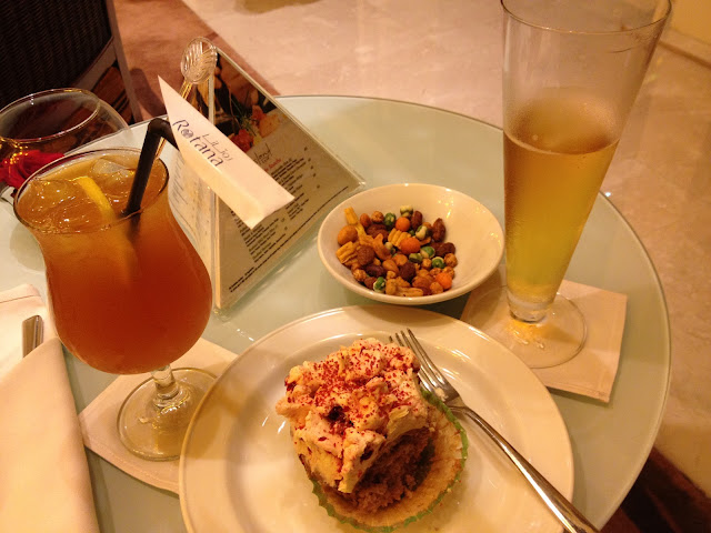 beer, nuts, iced tea and strawberry cupcake in Island Cafe Rotana Hotel Yas Island Abu Dhabi