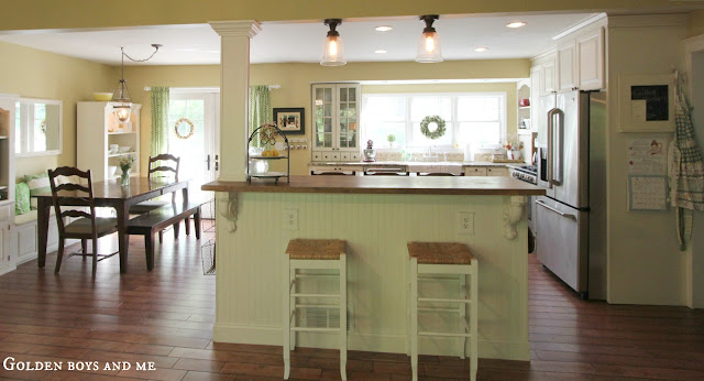 DIY Ikea Hack Kitchen Island with beadboard and butcher block countertop with Billy bookshelves and open floor plan kitchen via www.goldenboysandme.com