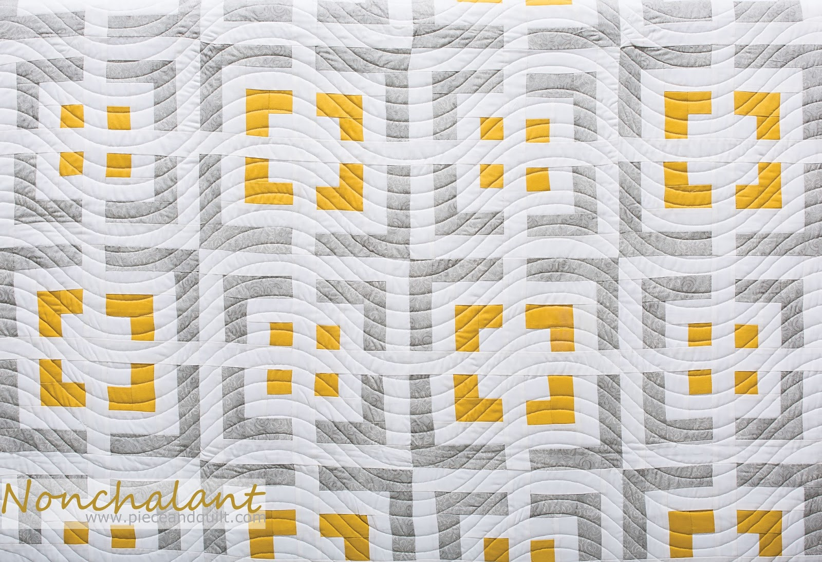 piece n quilt nonchalant  cabin fever  modern log cabin quilts - i really love this quilt and when i was ready to machine quilt it i choseto quilt an edge to edge wave pattern because the quilt is so geometricand crisp