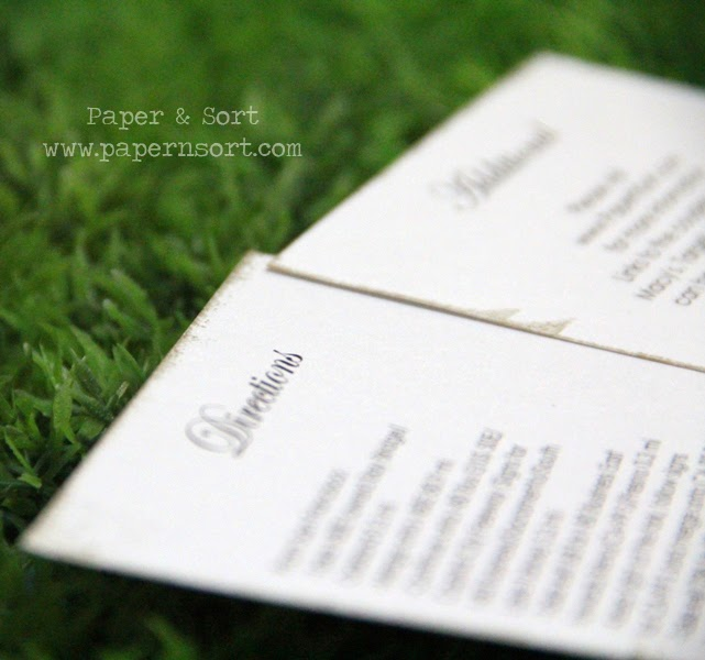 shimmery white enclosure card with edges inked in gold
