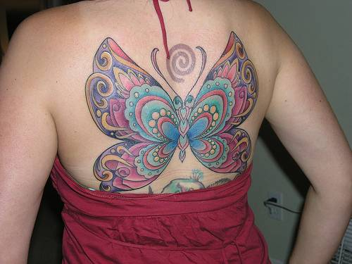 to make the tattoo look unique Butterfly Tattoo Women42