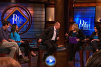 Dr. Phil seated talking to several psychic mediums on his show
