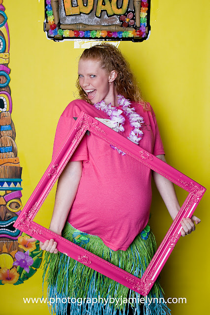 maternity pregnant woman hawaiian photobooth hot pink picture frame, grass skirt
