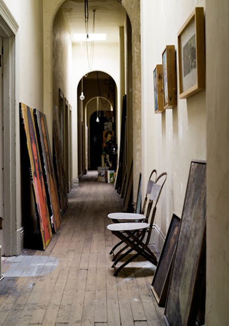 paintings leaning against the wall