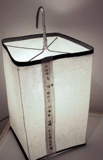 peint à la main - lampe KUB - design -lampe - deco - aix en provence - creation- fait main - made in france - luminaire - luminaires - à poser - à suspendre - lin- toile de jute - PcM - pcm - lampe de couleur - eco design - matières naturelles - matériaux recyclés - pièces uniques - petites séries - décoration - artisanat - baladeuse - lampe POM - cintre - bonbonne d'eau - recyclage - pom - cordon textile - lampe fruit - drapée - amidonné - amidon - textile - fibre végétale - rayures - bonbon – provence – cintres de pressing – brode – couds – couture – broder – souder – soude – dessin de modèles – créations – fabrication française – produits locaux – exposition – peinture à l'eau – tissu – lampe textile – cousu main – 100 % fait main – pascale marquier – modèle unique - lampe personnalisable - personnalisable – lumineuse – lumière – lumières – ceci n'est pas un cintre – homologation – norme CE - homologuée