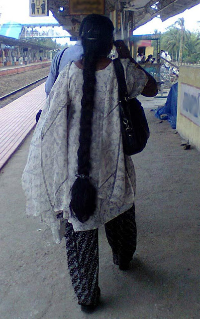 Very long hair braided women in railway station.