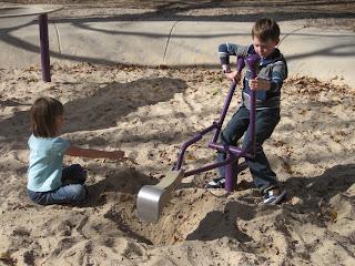 Dash on the digger, Mabel sprinkling sand