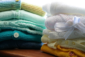 What we really needed for our newborn: hand knitted cardigans