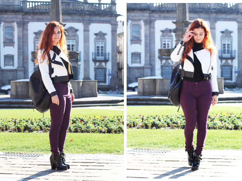fashion blogger wears berry pants and black and white jacket, with buckled boots