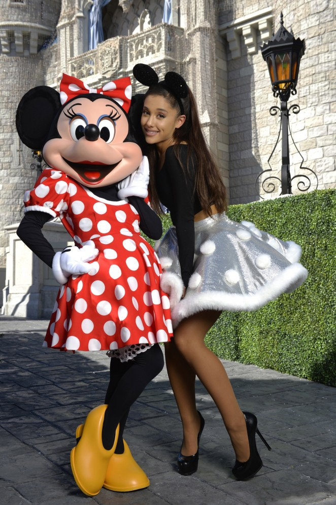 Ariana Grande slips into short skirt to perform at the Disney Parks Christmas Parade in Orlando